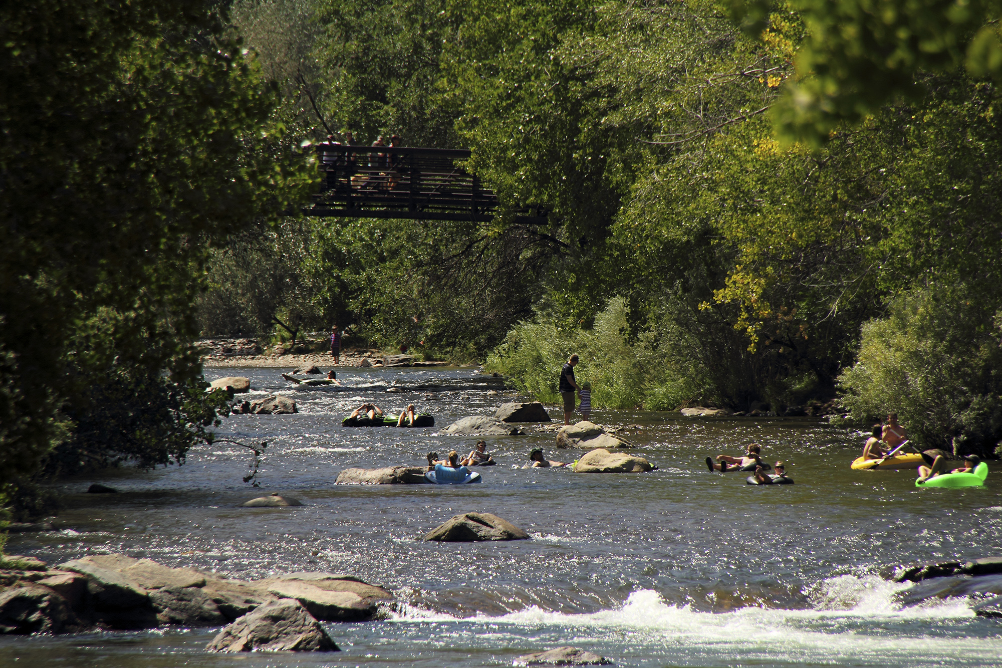 Tubers beat the heat by floating down Clear Creek in Golden, Colorado.