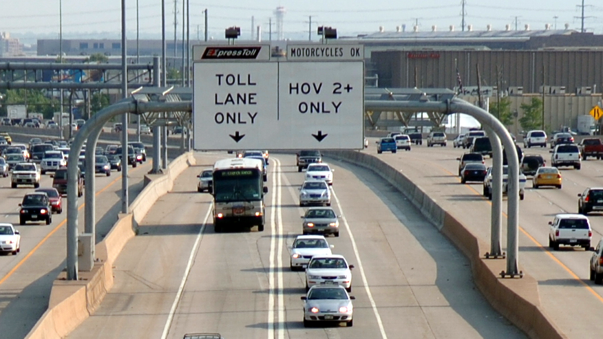 <p>A view of one an ExpressToll lane in metro Denver. Starting Jan. 1, 2017, drivers will need two passengers to use the lane for free.</p>